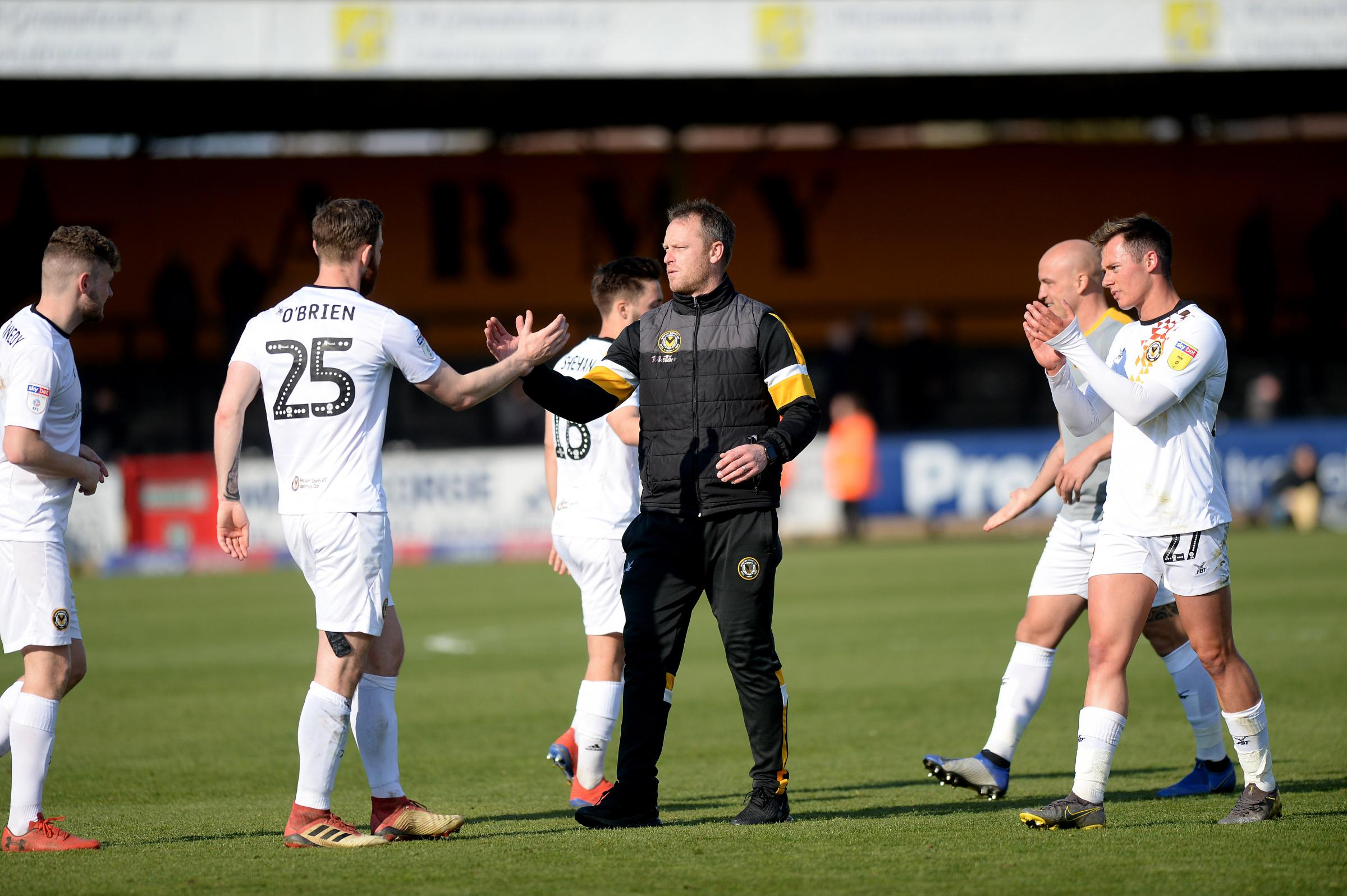 PROUD: Newport County manager Michael Flynn congratulates his players after the 3-0 win at Cambridge United. Pictures: Huw Evans Agency