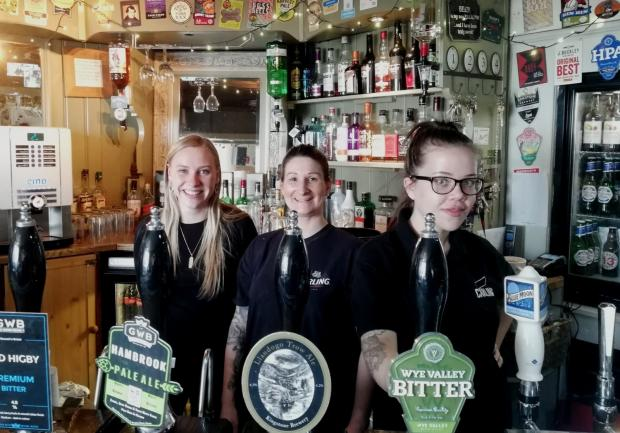 South Wales Argus: Manager of The Three Tuns, Tracey Morgan (centre) with staff.