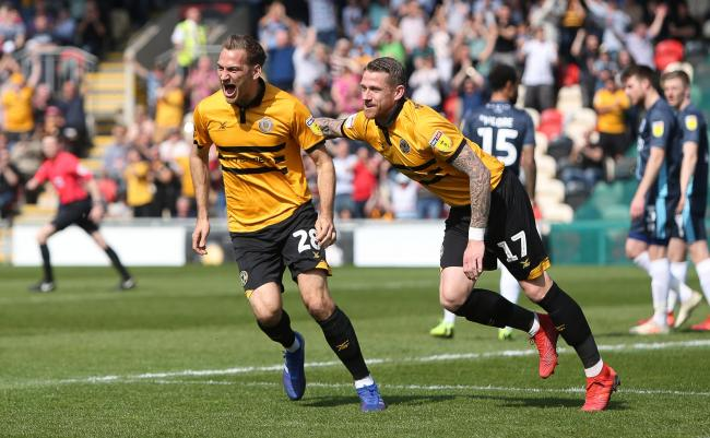 JOY: Mickey Demetriou, left, celebrates the first of his two goals with Newport County teammate Scot Bennett as Bury are beaten 3-1 at Rodney Parade. Pictures: Huw Evans Agency