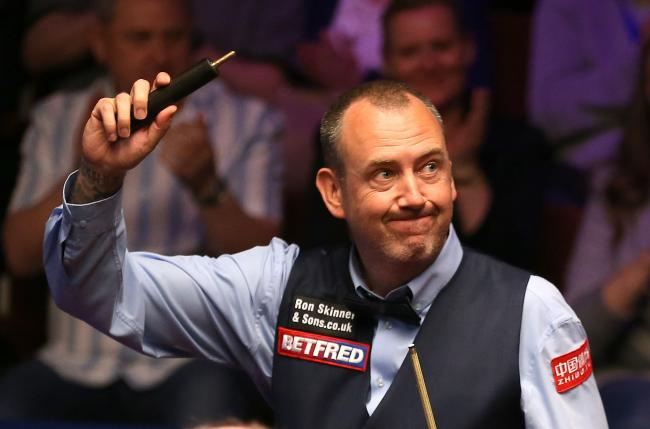 CHAMPION: Cwm's Mark Williams celebrates his victory over Martin Gould on day one of the 2019 Betfred World Championship at The Crucible. Picture: Nigel French/PA Wire