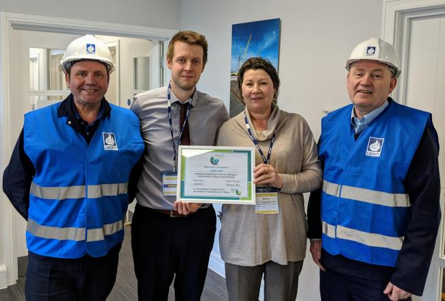 Newport Credit Union's General Manager Ben West and Payroll Development Officer Sue Riley with David Hughes and Mark Harrison of Liberty Steel