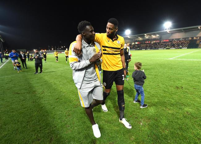 SUPPORT: Newport County academy graduate Momodou Touray congratulates first-team striker Jamille Matt after Tuesday's win over Oldham Athletic