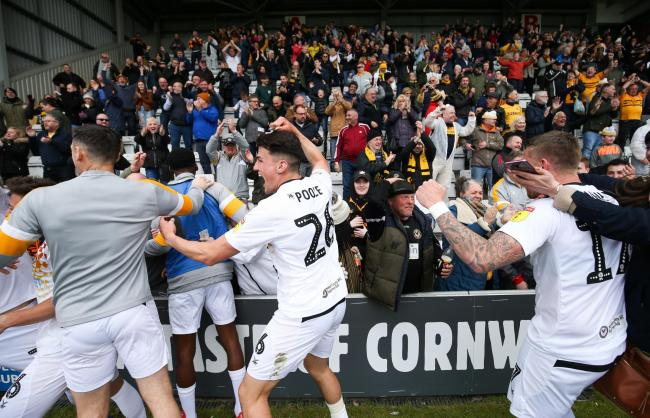 JUBILATION: Newport County players celebrate with fans at Morecambe on Saturday after sealing their place in the play-offs. Picture: Huw Evans Agency