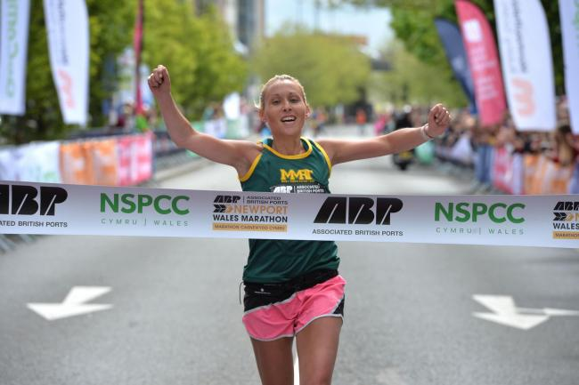 FIRST PLACE: Newport's Carla Swithenbank crosses the line to win the ABP Newport Marathon women's race. Picture: christinsleyphotography.co.uk