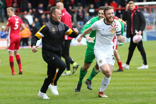 TRIUMPH: Newport County manager Michael Flynn, star man Joe Day and captain Mark O'Brien celebrate making the play-offs