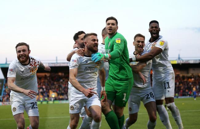 JUBILATION: Goalkeeper Joe Day and his Newport County teammates celebrate with the fans at Mansfield Town