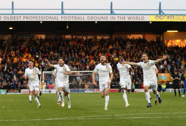 VICTORY: Newport County celebrate their penalty shootout win at Mansfield Town. Pictures: Huw Evans Agency