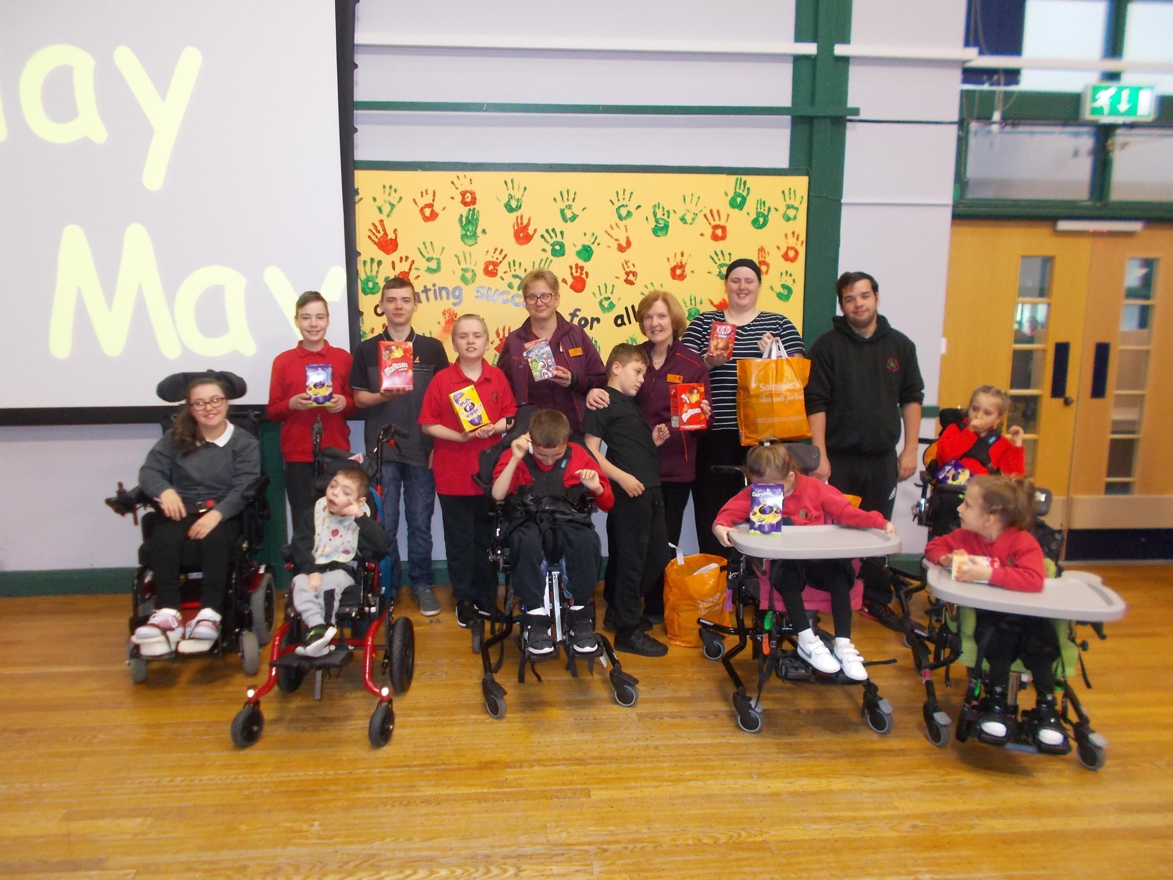 Pontllanfraith Sainsbury's donate eggs to Trinity Fields special needs school. Pictured are Linda Korczynski and Sally Grandon of Pontllanfraith Sainsbury's with pupils from the school
