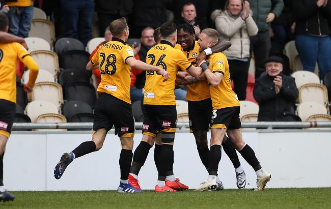Newport County celebrate scoring a goal with team mates