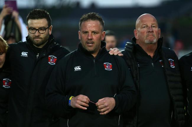 DEJECTION: Leighton Jones, centre, with Ben Jeffreys, left and Peter Jeffreys, right