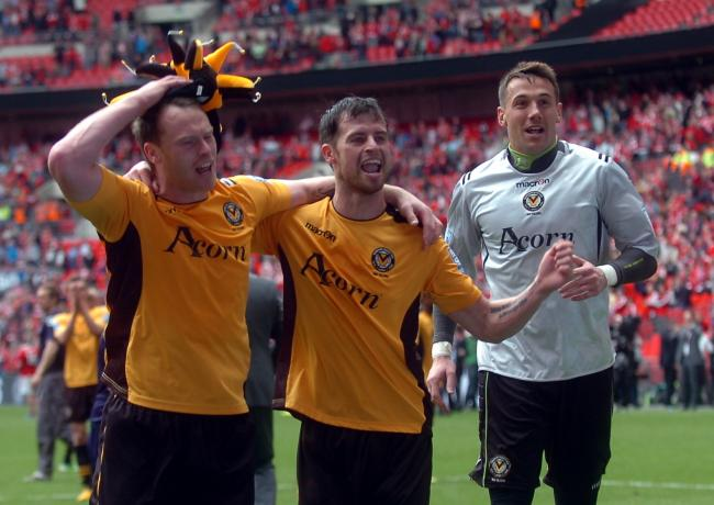 WHAT A DAY! Lenny Pidgeley, right, celebrating promotion at Wembley in 2013 with Michael Flynn, left, and Byron Anthony