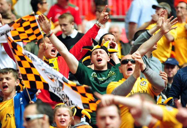 SUPPORT: Newport County fans cheering their side on to promotion at Wembley in the 2013 Conference play-off final