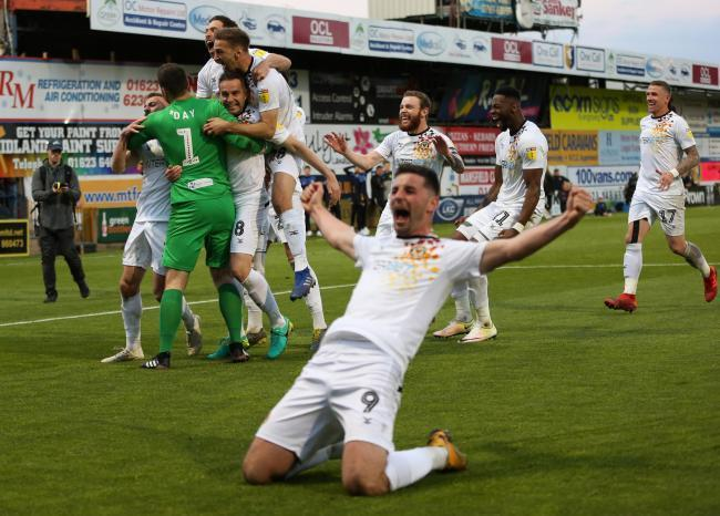 JUBILATION: County players celebrate after the League Two play-off semi-final penalty shoot-out drama at Mansfield