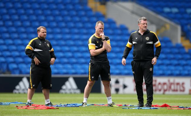 PLANNING: County are back in training with manager Michael Flynn (centre) and Wayne Hatswell (right) (Picture from files)