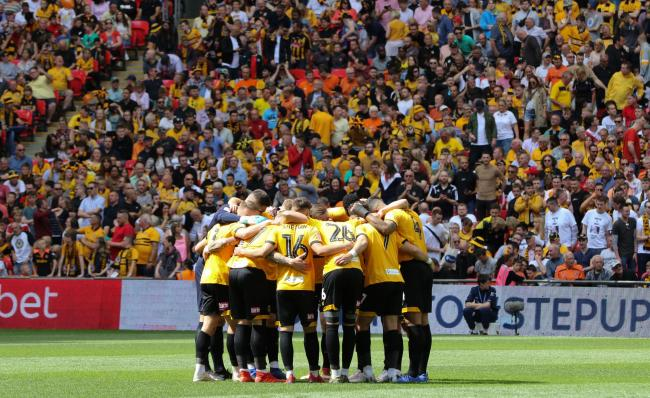 TOGETHER: The Newport County players form a huddle before kick-off at Wembley. Pictures: Huw Evans Agency
