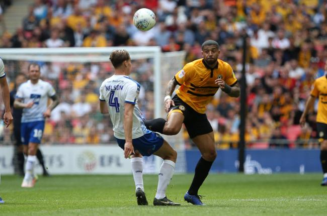 25.05.19 - Newport County v Tranmere Rovers - SkyBet League Two Play-off Final - Joss Labadie of Newport County is tackled by Sid Nelson of Tranmere Rovers.