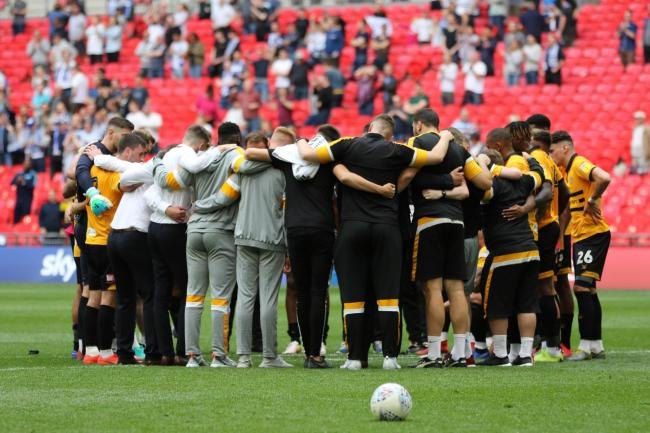 TOGETHER: Newport County players and staff in a huddle at Wembley after losing the League Two play-off final to Tranmere Rovers in May