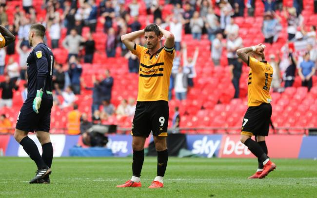 DESPAIR: Newport County striker Padraig Amond shows the pain of defeat to Tranmere Rovers in the League Two play-off final at Wembley