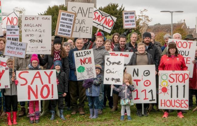 Campaigners protesting against the plans. Picture: Robert Hughes