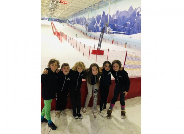 South Wales Argus: The Usk CIW Primary ski teams pose in front of the slopes at Manchester's Chill Factore.