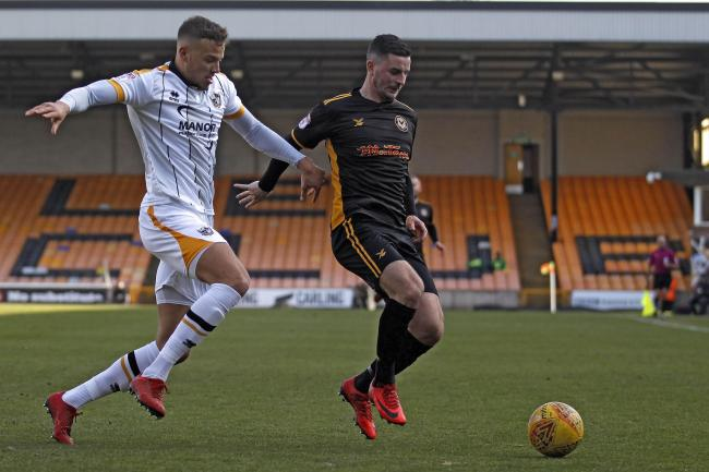 NEW FACE: Kyle Howkins, left, in action for Port Vale against Newport in February 2018